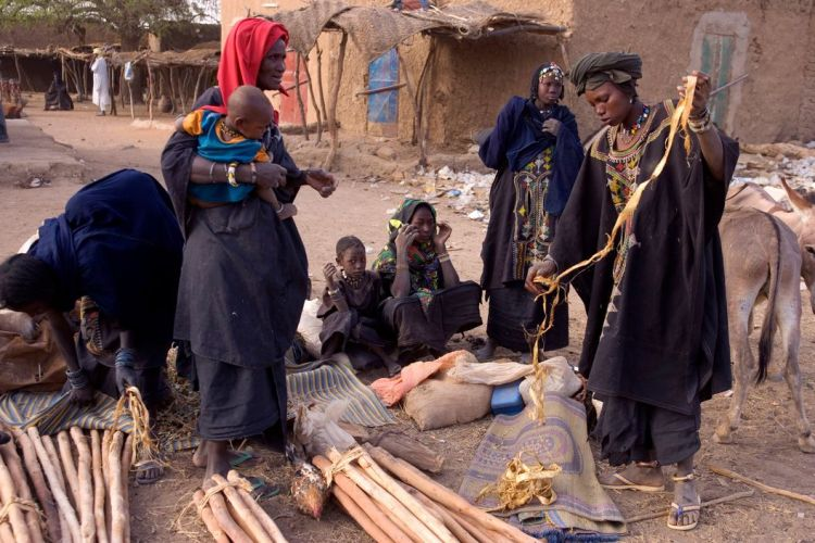 NIGER. Ayorou. The Sunday market,Tuareg slaves with anklets. 2005