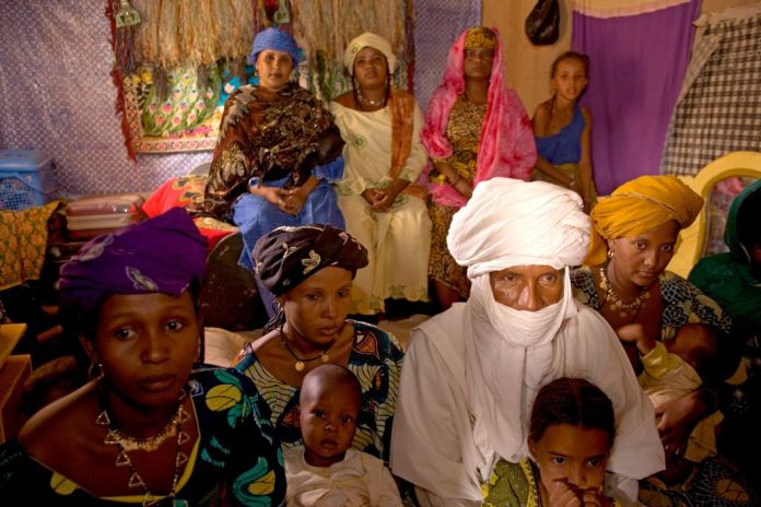 NIGER. Tajae. Slave trader and Tuareg chieftain Ibrahim Agali with his wives and family members inside the Tuareg palace. 2005.