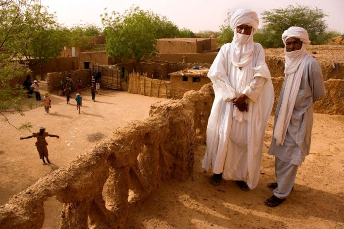 NIGER. Tajae. Tuareg chieftan Ibrahim Agali (l) with his cousin Sayadi Ibrahim (r) in the Tuareg palace. 2005.